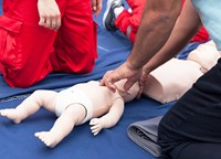 first aid and resuscitation on doll