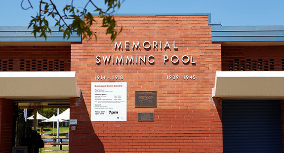 Carnegie Memorial Pool's red brick facade showing memorial plaques
